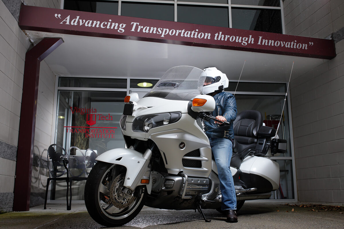 Motorcycle driver in front of VTTI entrance